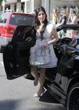 Kim Kardashian shows cleavage in light summer dress shopping at Intermix boutique on Robertson Blvd in Los Angeles