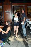 Lindsay Lohan leggy in denim shorts and busty in white top at Bar Pitti in Manhattan